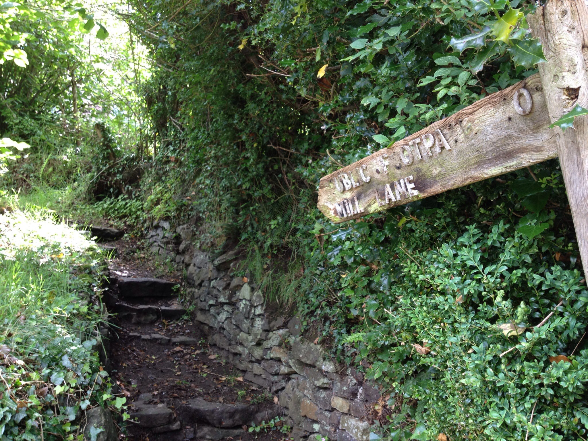 Public footpath sign and steps to Mill Lane
